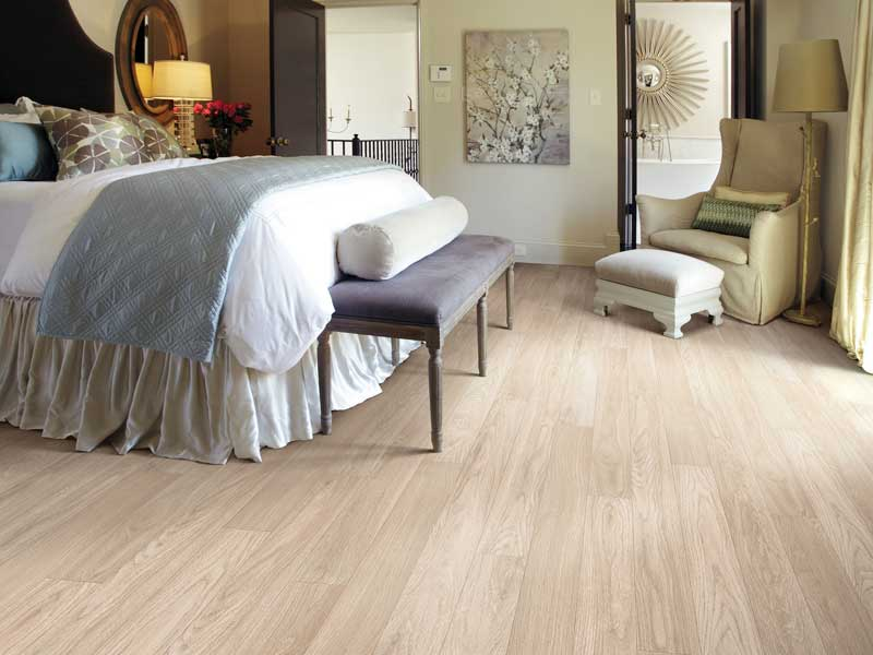light colored laminate flooring in bedroom